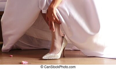 Bride showing her shoes - Bride showing shoes slightly...