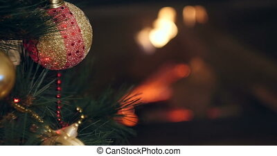 details of christmas decorations with burning fireplace in...