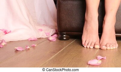 rose petals falling at the feet of the bride slow motion