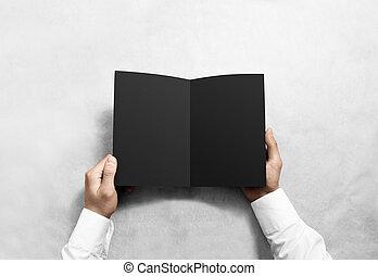 Hand opening blank black brochure booklet mockup. Leaflet...
