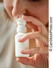 close up of sick woman using nasal spray - healthcare, flu,...
