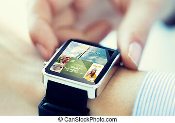 close up of hands with application on smartwatch - business,...