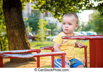 Happy smiling and handsome boy kid having fun playing at...