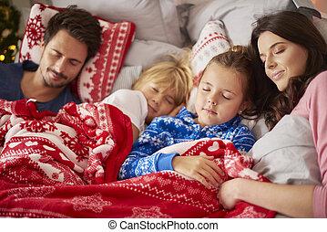 Sleeping family in Christmas morning