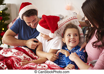Spending Christmas morning with family in the bed