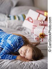 Sleeping girl in Christmas morning