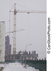 Construction of a multistory building in the harsh winter...