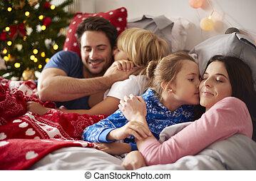 Loving family in Christmas morning