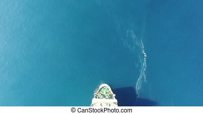 Aerial view of a Cargo vessel. Swims over the frame.