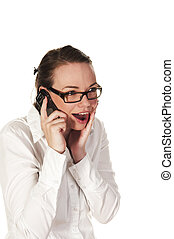 Beautiful girl getting good news on the phone, seen against...