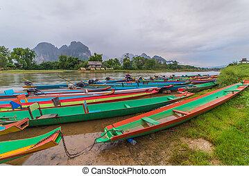 long tail boats on Song river, Vang Vieng, Laos