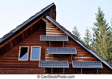 Solar panel on a lodge - Solar panel on a wooden house