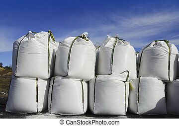 salt white sacks rows stacked to road ice - salt white sacks...