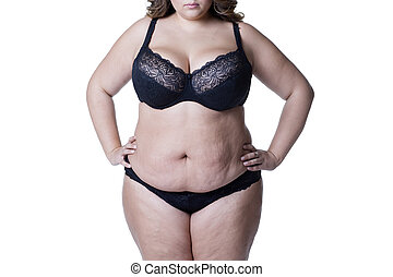 Plus size model in black lingerie, overweight female body, fat woman with stretch marks isolated on white background