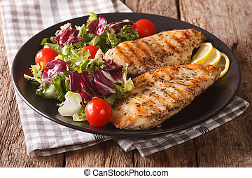 roasted Chicken breast with mix salad of chicory, tomatoes...