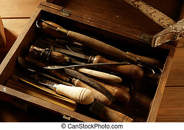 srtist hand tools for handcraft works on golden wood...
