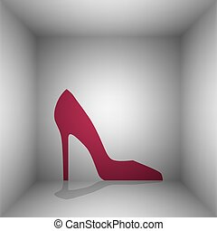 Woman shoe sign. Bordo icon with shadow in the room.