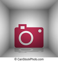 Digital camera sign. Bordo icon with shadow in the room.