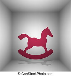 Horse toy sign. Bordo icon with shadow in the room.
