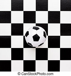 soccer ball on chequered pattern - soccer ball on chequered...