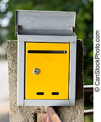 Yellow mailbox in front of the house - Mailbox in front of...
