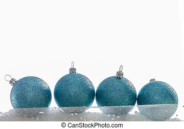 Four turquoise Christmas baubles isolated on white.