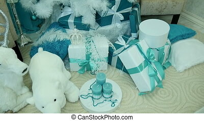 Presents under decorated Christmas tree. White bears.