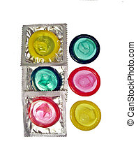 Condoms of different colors on a white surface