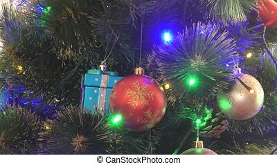 Multicolored lights on the Christmas tree - Multicolored...