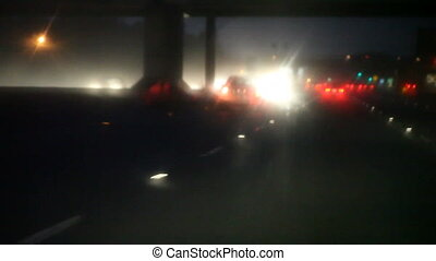 heavy rain on California freeway - night traffic in a heavy...
