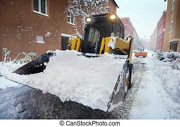 Snow plow for road cleaning in Stockholm, Sweden