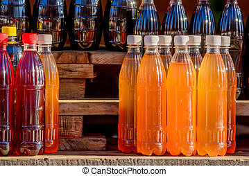 Homemade mead in various jars at traditional Russian fair