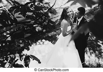 A pictude of smyling bride standing with a fiance in the...
