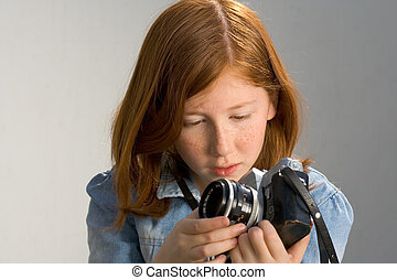 Girl with old SLR photo camera - Girl holding old SLR photo...