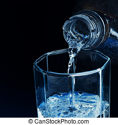 fresh water pouring into glass