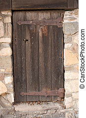 Old door - Old wooden door in stonewall