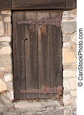 Old door - Old wooden door in stonewall