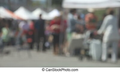 farmers market - shoppers at a farmers market on a sunny day