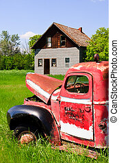 Old Red Farm Truck - Old rusty red farm truck fading in time...