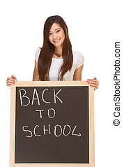 Back to school Asian female student by blackboard - Friendly...