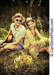 enamored young couple - Enamored young man with a guitar...