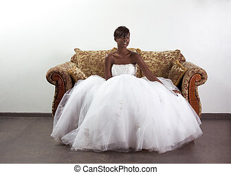 Young ethnic black woman bride in wedding dress - African...