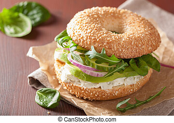 avocado sandwich on bagel with cream cheese onion cucumber...