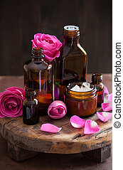 natural cosmetic in glass jars and rose flowers aromatherapy...