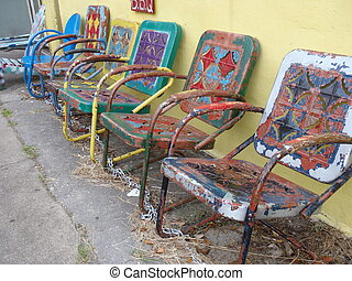 Laid Back - Colorful old lawn chairs in New Orleans