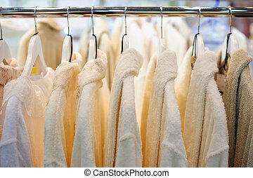 white man shirts on hangers in store