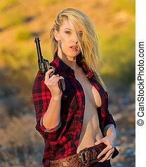 Blonde Model in Desert With Gun - Blonde female model posing...