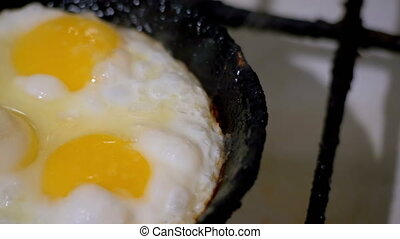 Fried Eggs Prepared on a Frying Pan - Fried eggs fried in a...