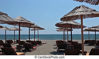 Straw parasols on the sandy beach of Ulcinj, Montenegro