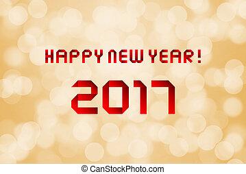 Happy new year 2017 on orange bokeh background.